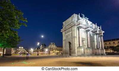 Illuminated Arc de Triomphe du Carrousel at night timelapse