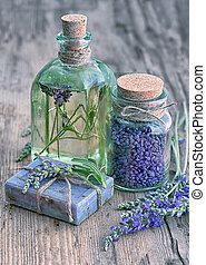 lavender oil, herbal soap and bath salt with flowers -...