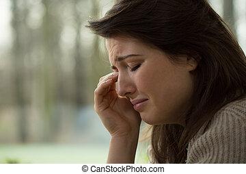 Sobbing woman - Close-up of young melancholy sobbing woman