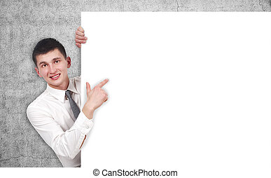 businessman pointing to blank poster