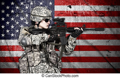 soldier holding rifle on american flag background