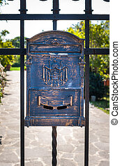 Letter box wrought iron with decorations .