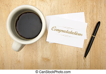 Congratulations Note Card, Pen and Coffee Cup on Wood...