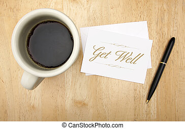 Get Well Note Card, Pen and Coffee Cup on Wood Background