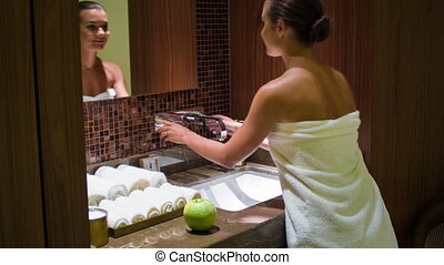 Beautiful woman in the bathroom - elegant girl washes her...