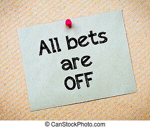 All bets are off Message Recycled paper note pinned on cork...