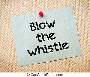 Blow the whistle Message. Recycled paper note pinned on cork...