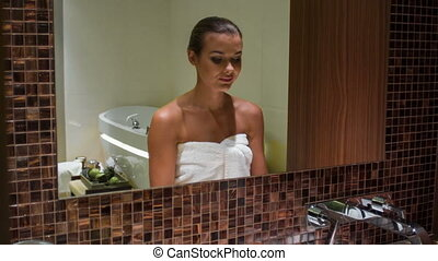 Beautiful woman in the bathroom - girl take care of herself...