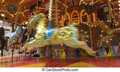 Old vintage carousel spinning