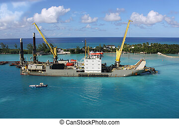 Sand digger in Nassau - Industrial ship that digs sand...