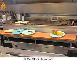 Commercial Kitchen - A commercial kitchen including a large...