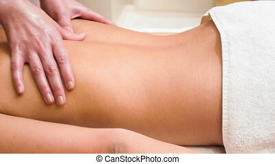 Back massage at spa - Masseuse giving a relaxing back...