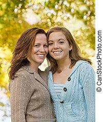 Mother Daughter Smiling Pretty in the Park