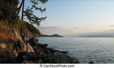 Sunrise on Baikal lake. Chivirkuy Bay. The Holy Nose...