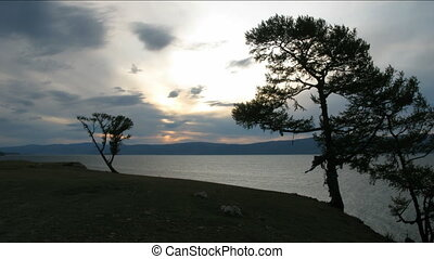 Dramatic sunset on Baikal lake Olkhon island