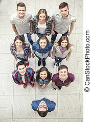 People group - Top view Happy smiling young group looking at...