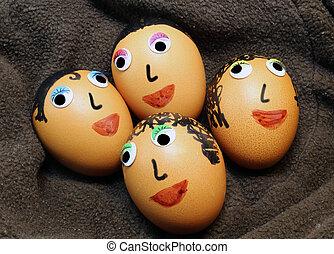 grande, huevos, adornado, con, ojos, y, pelo,