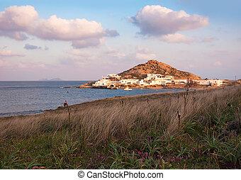 Kalafatis Bay beach on the island of Mykonos at sunset...