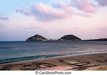 Kalafatis Bay beach on the island of Mykonos at sunset...