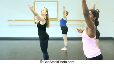 Ballet dancers (ballerinas) practicing and rehearsing inside...
