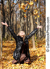 beautiful girl throwing up autumn leaves - beautiful young...