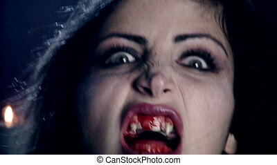 vampire with blood attacking camera - Female vampire looking...
