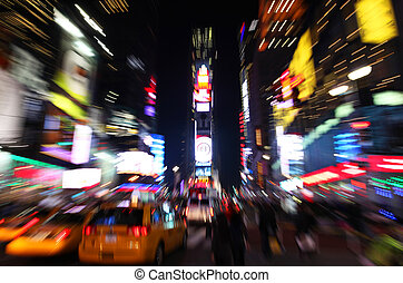 The times square at night in the New York City with zooming...
