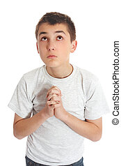 Boy in prayer looks to heaven for answers - Boy with hands...