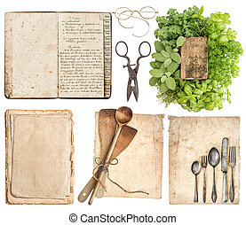 kitchen utensils, antique cookbook, aged paper pages and...