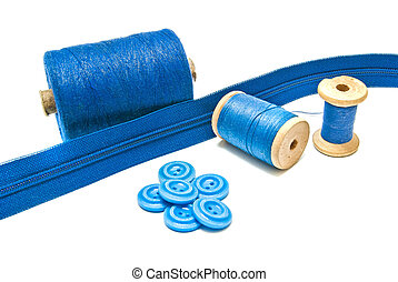 spools of blue thread and buttons on white