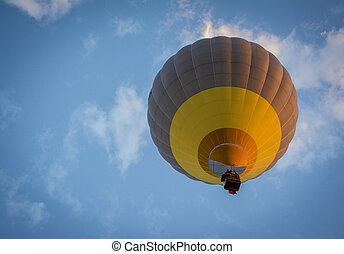 Hot air balloon rising at dusk