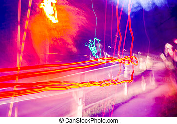 Long Exposure - Long exposure of a vehicle traveling at...