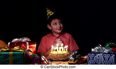 Birthday worries make wish and then blows out the candles on...