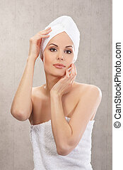 Young attractive woman in towel