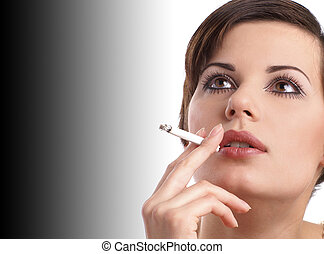 Attractive retro woman smoking over black and white...