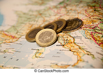 Euro coins on a map of italia