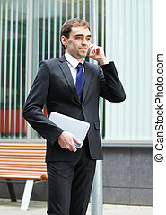 Young and smart business man talking on the phone