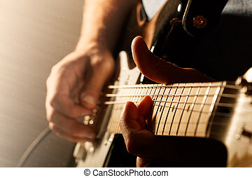Man playing electric guitar - Hands of man playing electric...
