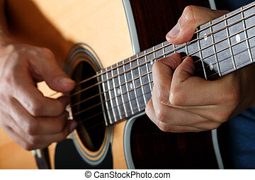 Acoustic guitar player performing song Hands closeup