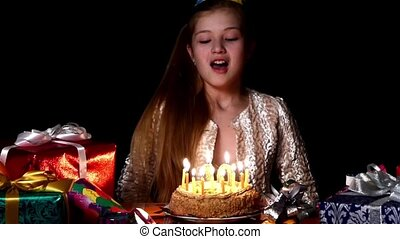 Birthday girl worries make wish and then blows out the...