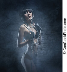 Fashion shoot of young bizarre woman in fetish dress -...