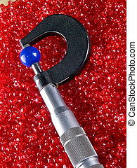 Micrometer with Beads and Balls. Plastic colorful beads and...