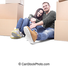 Couple moving in new house - Happy Young couple moving in...