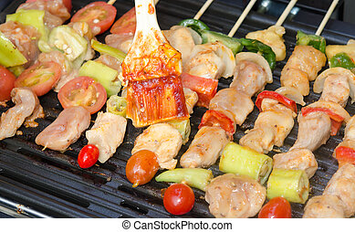 barbecue - Grilling chicken on barbecue grill