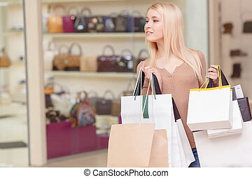 Girl holds shopping bags in her hands - Exciting world of...