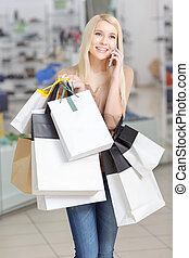 Use of phone at shopping - Best time for shopping. Beautiful...