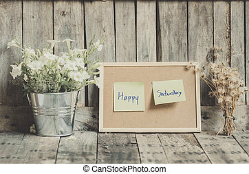 Vintage style effect Happy Saturday message on corkboard...