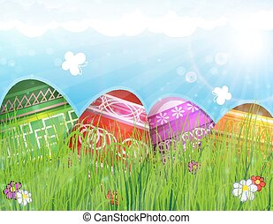 Easter eggs on meadow