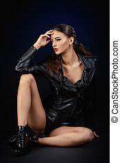 leather fashion - Attractive young woman alluring in fitting...