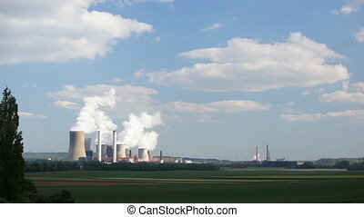 Power Station In The Distance - A large steaming coal-fired...